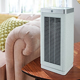 MeacoHeat MotionMove Eye Fan Heater 1000-2000 Watts White In Living Room On Table - Aerify