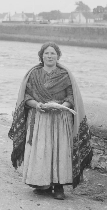 Woman wearing a traditional Galway Shawl in Ireland