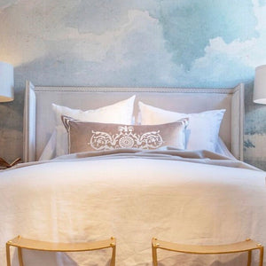 bed made with white linen