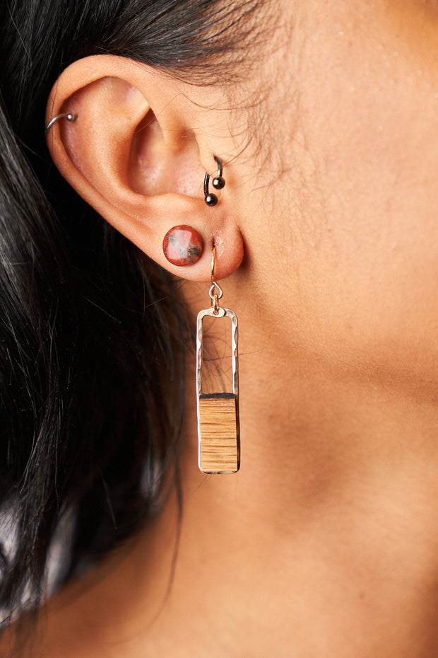 ​Branch and Barrel Designs barrel stave rectangle earrings. Hand-cut reclaimed oak barrel stave framed with hand-forged 14k gold fill or sterling silver. Your choice of bourbon or red wine barrel.  Buy One Plant One - One Tree Planted for every Branch+Barrel piece sold!