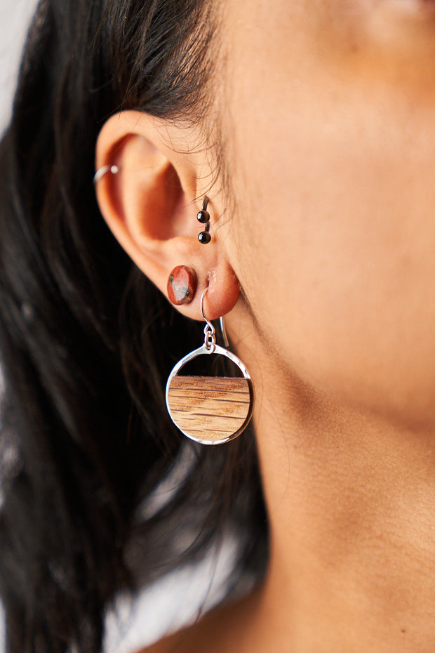 Branch+Barrel Small Barrel Stave Hoop Earrings. Reclaimed oak barrel stave framed in hand forged sterling-silver or 14k gold-fill. Your choice of either red wine or bourbon barrel stave.  Buy One, Plant One - One tree planted for every Branch+Barrel piece sold.
