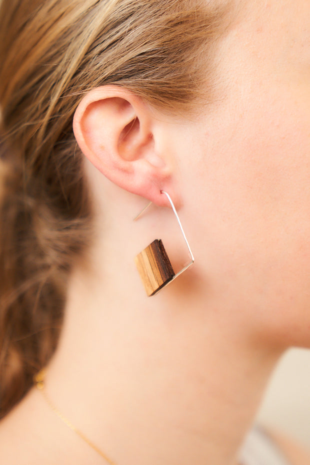 Branch+Barrel pull through diamond barrel stave earrings.  Reclaimed Oak Bourbon or Wine Barrel Stave framed with your choice of barrel stave and hand-Forged Sterling Silver or 14k Gold-Fill.  Buy One Plant One - One Tree Planted for every Branch+Barrel piece sold!