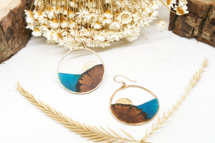 "Branch+Barrel ""Atoll"" Juniper Earrings  Hand cut Juniper paired with a hand tinted resin, and accented with a textured metal disc and framed in your choice of Sterling Silver or 14k Gold-Fill.  *New Design*  Buy One Plant One - One tree planted for every Branch and Barrel piece sold!"