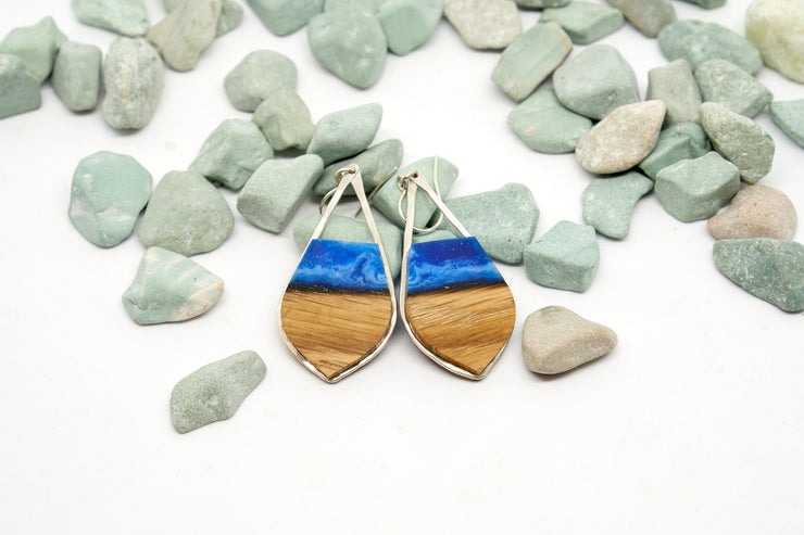 "Branch and Barrel ""Aurora"" - Pointed Teardrop Bourbon Barrel Stave Earrings  Hand cut reclaimed oak bourbon barrel stave topped with a hand-tinted blue resin and framed in hand forged sterling-silver or 14k gold-fill.  Buy One, Plant One - One tree planted for every Branch+Barrel piece sold."