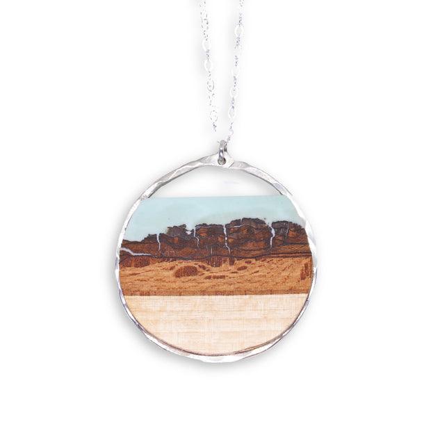 "Branch and Barrel ""Mesa"" Basswood Circle Pendant Necklace  Hand cut basswood with hand tinted resin, framed in your choice of hand forged sterling-silver or 14k gold-fill.  Buy One Plant One - One tree planted for every branch+Barrel piece sold!"