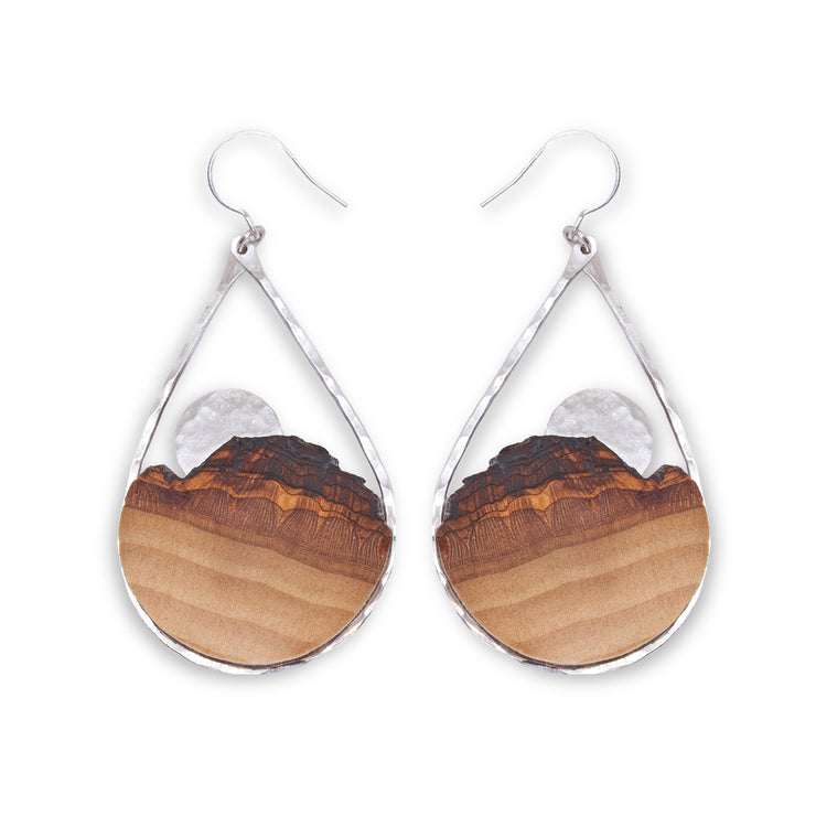 Branch and Barrel Basswood Sunrise Teardrop Earrings  Hand cut Basswood framed in hand forged sterling-silver or 14k gold-fill. sunrise disc hand cut and textured from the same metal as the frame.  Buy One, Plant One - One tree planted for every Branch+Barrel piece sold.