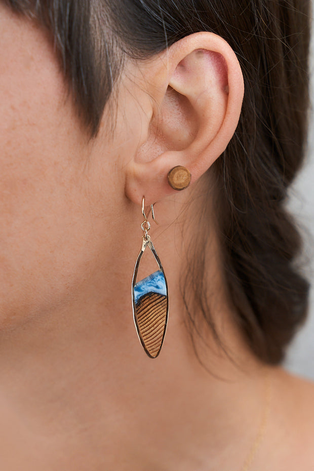 """Riptide"" - Oregon Coast Driftwood Earrings - Oregon coast driftwood framed in hand forged sterling-silver or 14k gold-fill and topped with a pacific ocean inspired hand-tinted blue resin.  Buy One, Plant One - One tree planted for every Branch+Barrel piece sold."