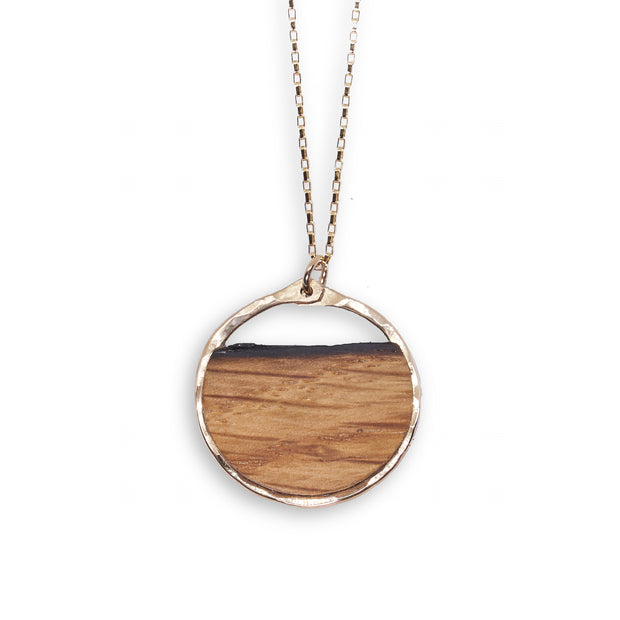 Branch and Barrel Reclaimed Oak Barrel Stave Circle Pendant Necklace  Your choice of hand-cut oak bourbon or wine barrel stave. Pendant is framed in your choice of hand forged sterling silver or 14k gold-fill.   Buy One Plant One Tree - One tree planted for every Branch+Barrel piece sold!