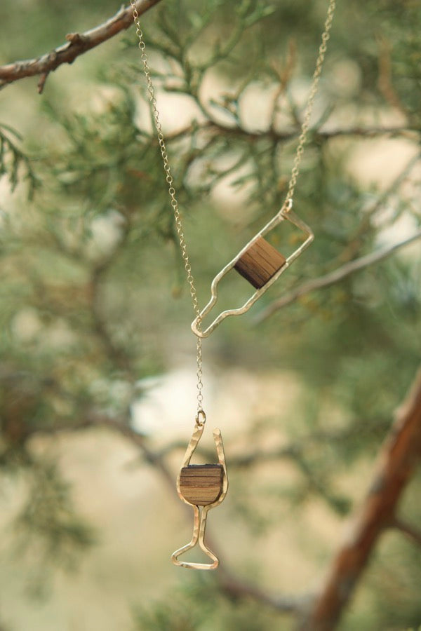 Branch and Barrel Oak Wine Barrel Stave Wine Glass and Bottle Lariat Necklace  Reclaimed oak wine barrel stave hand cut and shaped, framed in your choice of hand forged metal; 14k gold-fill or sterling silver  Buy One Plant One - One tree planted for every Branch and Barrel piece sold!