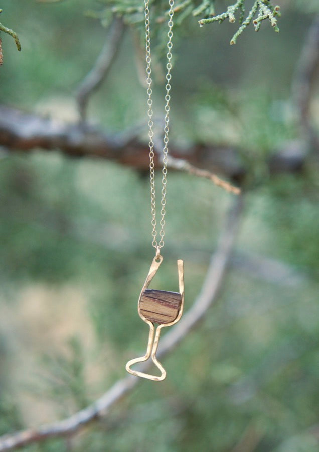 Branch and Barrel Wine Glass Barrel Stave Pendant Necklace  Reclaimed oak red wine barrel framed in your choice of hand forged metal, Sterling Silver or 14k Gold-Fill. Pendant hangs on a sterling silver chain.  Buy One Plant One - One tree planted for every Branch and Barrel piece sold!