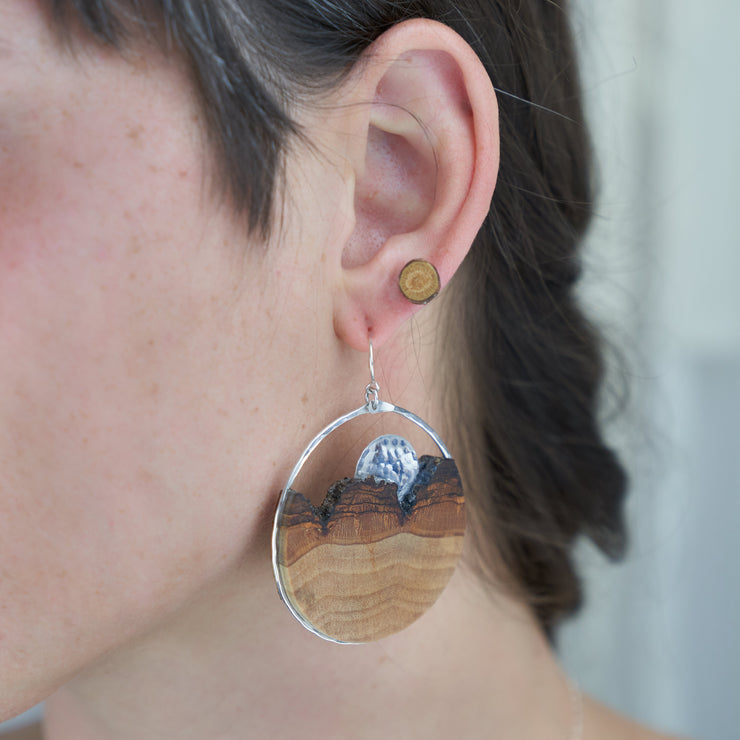 Branch and Barrel Basswood Sunrise Hoop Earrings  Hand but basswood framed in your choice of hand forged sterling silver or 14k gold-fill. The sunrise disc is hand textured and cut from the same metal as the frame.  Buy One Plant One - One tree planted for every Branch and Barrel piece sold!