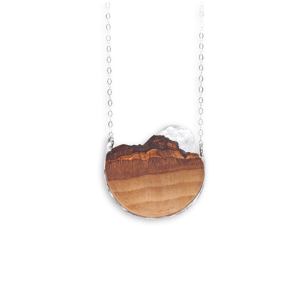 Branch and Barrel Basswood Sunrise Necklace  Hand cut Basswood framed in your choice of hand forged metal; sterling silver or 14k gold-fill. Sunrise disc hand textured and cut from same metal as frame.  Buy One Plant One - One tree planted for every Branch and Barrel piece sold!