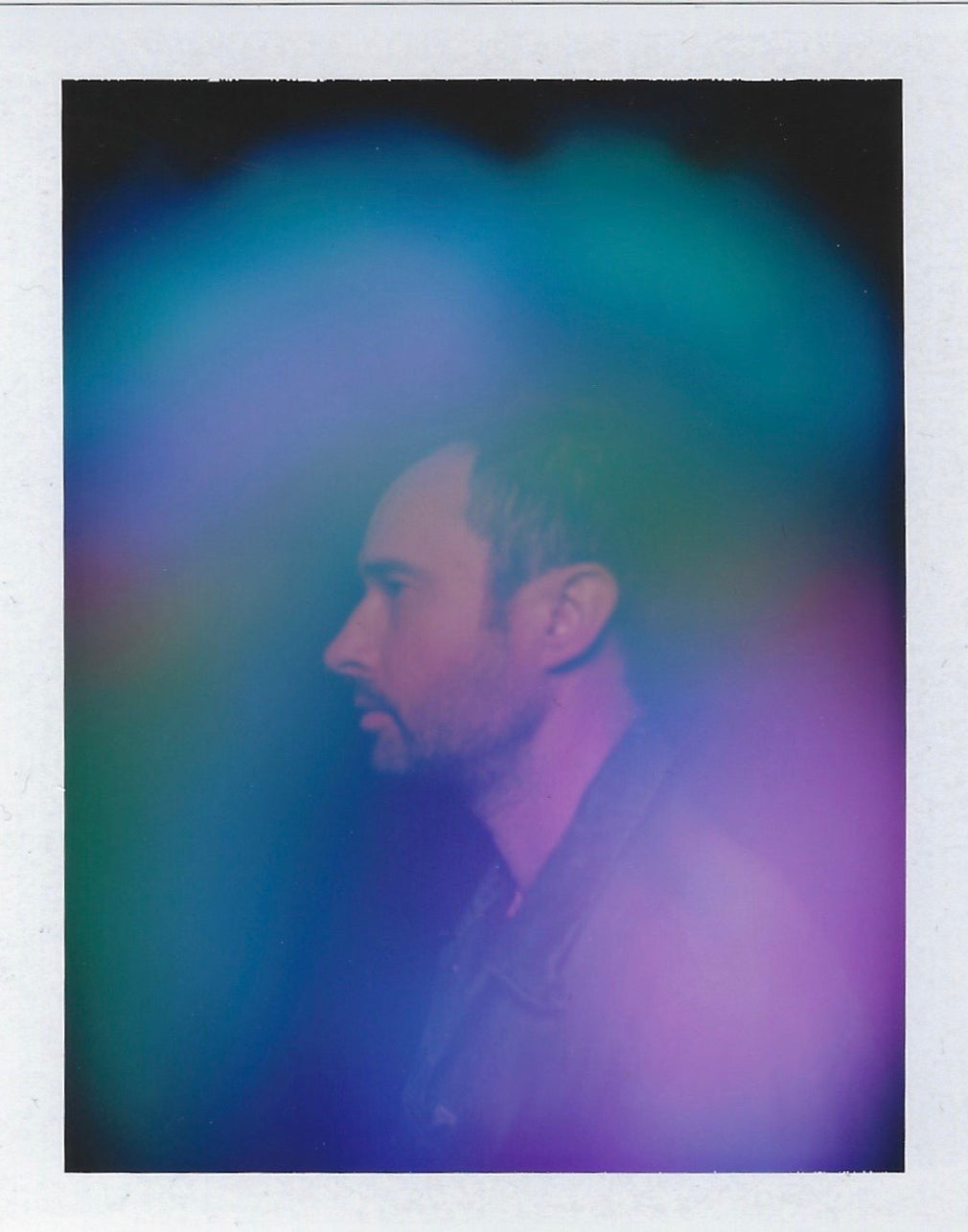 A photo of Etheric Body founder Michael Walker's blue, green and purple aura photograph by Halo Auragraphic.