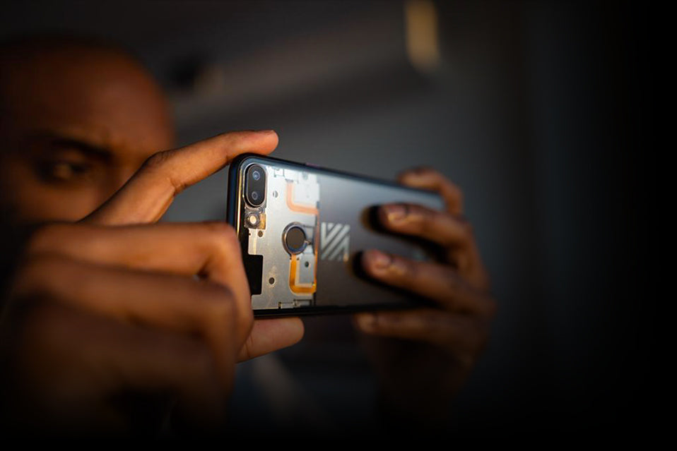 Man holding the ZmBIZI Z1 phone and taking a photo