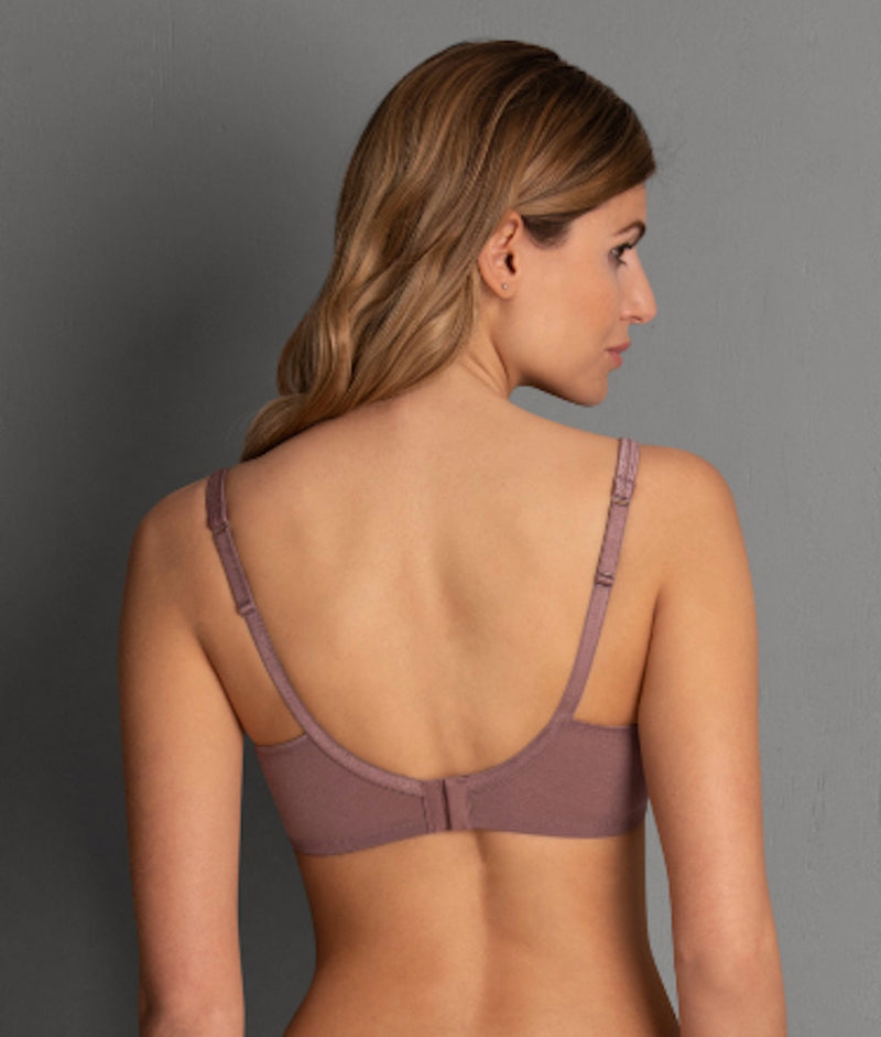 Berry colour. Back view. Sleek glamour features our soft bra FLEUR in romantic floral lace design, with a soft charmeuse lining of contrasting colour. The ultra comfortable soft cups are decorated with flat, delicate lace panels.  Cups - Silky, smooth microfibre fabric, wireless contour cups Straps - increasing with size range, adjustable in the back, centred positioning ensures optimum support Back - Three position hook and eye fastener