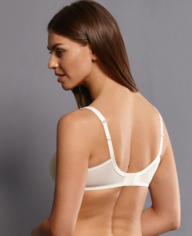 White back view. Sleek glamour features our soft bra FLEUR in romantic floral lace design, with a soft charmeuse lining of contrasting colour. The ultra comfortable soft cups are decorated with flat, delicate lace panels.  Cups - Silky, smooth microfibre fabric, wireless contour cups Straps - increasing with size range, adjustable in the back, centred positioning ensures optimum support Back - Three position hook and eye fastener