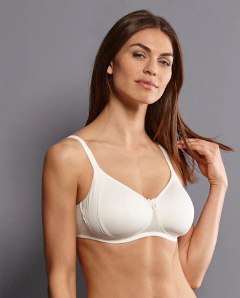 White front. Sleek glamour features our soft bra FLEUR in romantic floral lace design, with a soft charmeuse lining of contrasting colour. The ultra comfortable soft cups are decorated with flat, delicate lace panels.  Cups - Silky, smooth microfibre fabric, wireless contour cups Straps - increasing with size range, adjustable in the back, centred positioning ensures optimum support Back - Three position hook and eye fastener