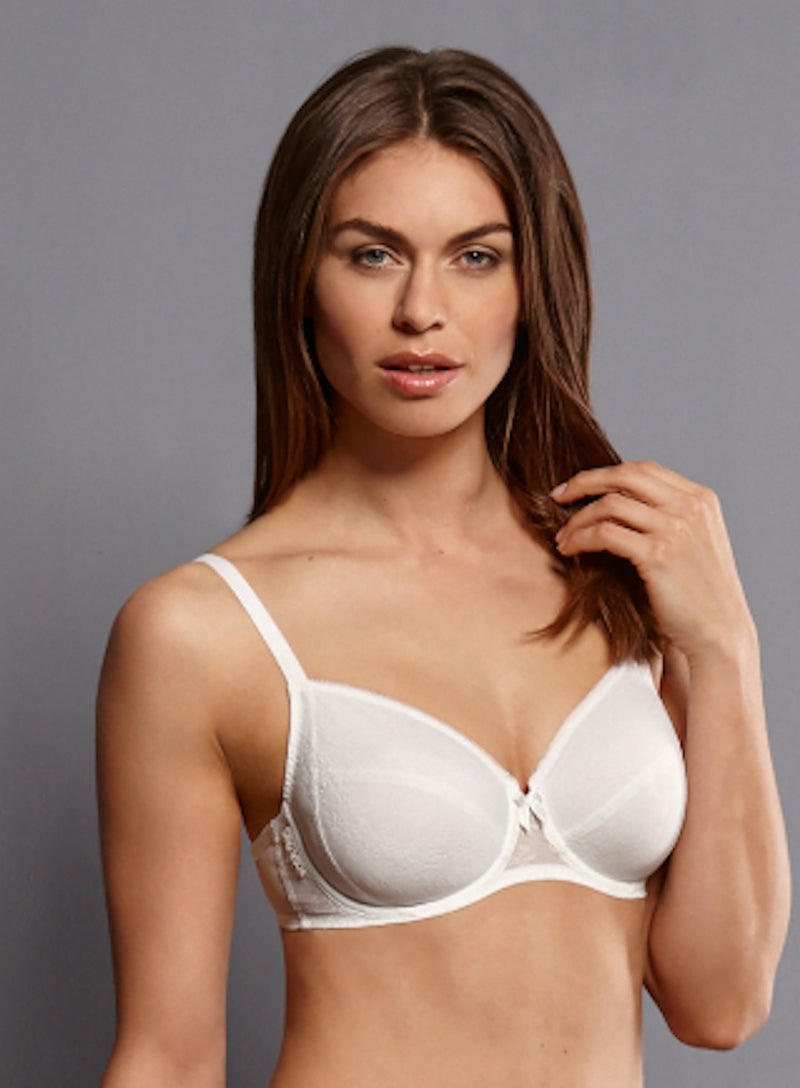 White front view. Our underwire bra in the beautiful seductive lace series FLEUR is available up to J cup. The Charmeuse lining provides a hint of opaqueness, while its functional shaped underwires provide a perfect fit.  Smooth floral lace with opaque charmeuse lining  Cups - Continuous frame ensure best support, seamless inner lining, particularly soft edgings Straps - Increasing with size range Back - Centered positioning of the straps ensures optimum support, three position hook and eye fastener