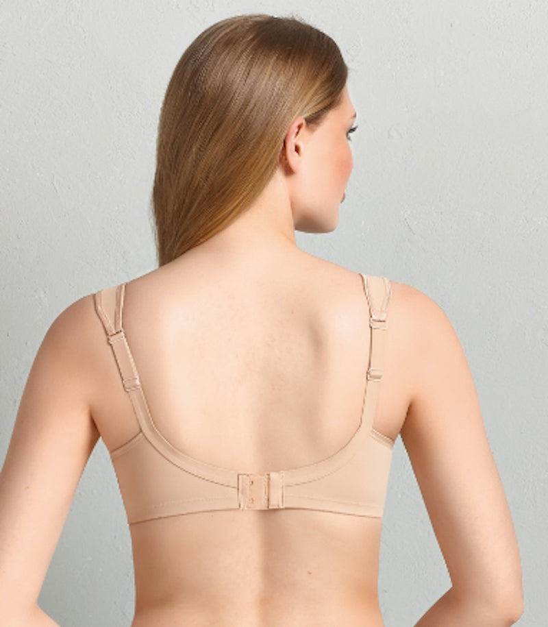 Beige back view. Minimalist but still effective! The super-snug comfort bra from the CLARA range features impressive styling.Adjustable, wide comfort straps guarantee firm support. The pre-shaped cups ensure an attractive breast form up to cup size G.  The lightweight, seamlessly shaped comfort bra has a supporting effect due to the SuperMicro fabric. The adjustable comfort straps are padded on the shoulders and are wider in the larger sizes.
