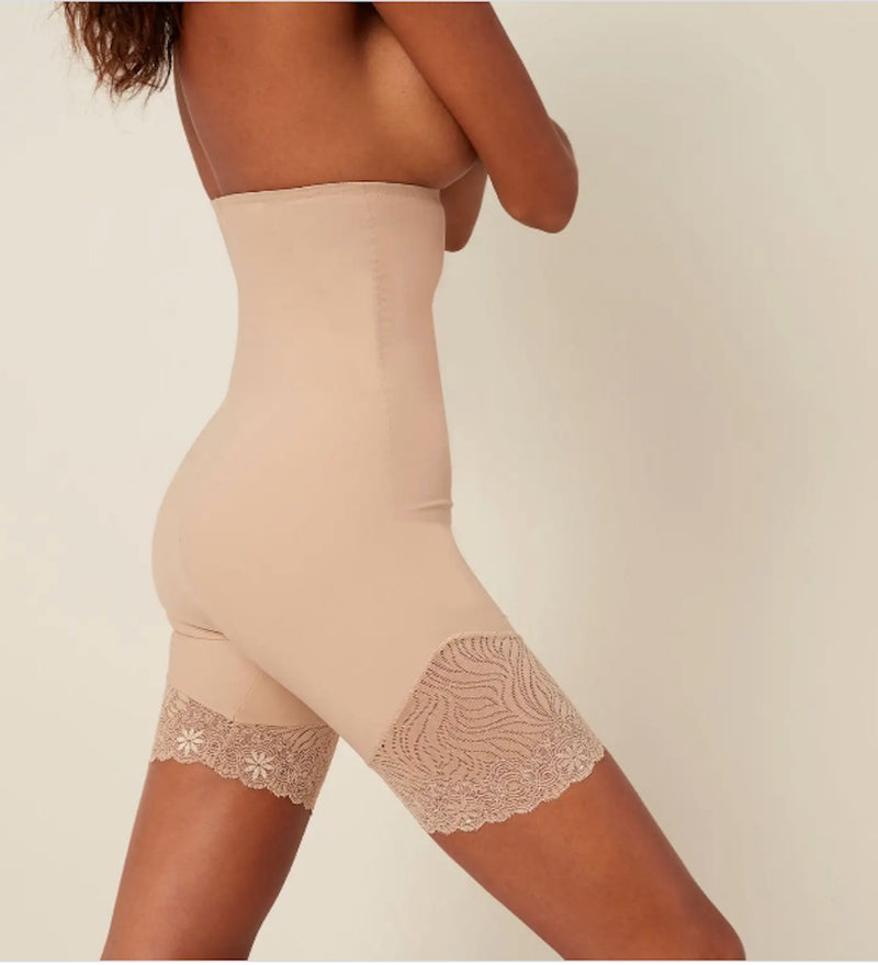 Simone Perele full shaper, high waist shapewear. Skin colour. TOTAL SMOOTHING  Elegant and chic zebra lace accents on the thighs lay flat against your skin for a crease-free finish and discreet look under skirts and dresses.   SUPPORT Shapes the waist and tummy Elasticized waist with silicone lining to prevent slipping or rolling for all-day comfort that stays in place.