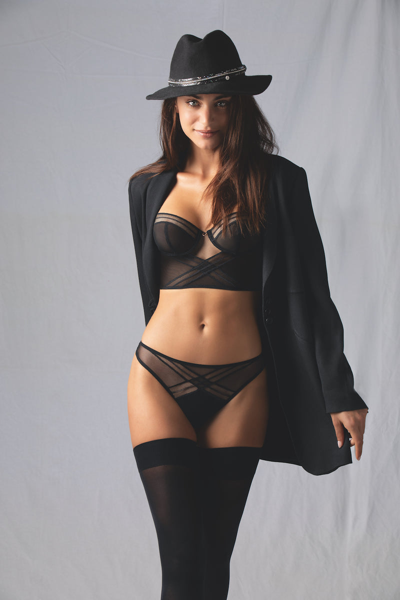 Fall under the spell of this new sexy Soir Adrenaline line of black lingerie from Antigel by Lise Charmel. Choose this tanga with tulle or the boyshort. Add the matching sexy bustier or an underwire bra from the collection to complete the look. Or, go all in with a long sleeve bodysuit to bring mystery to everything.