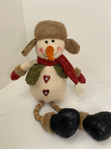 Snowman sitting with beaded legs