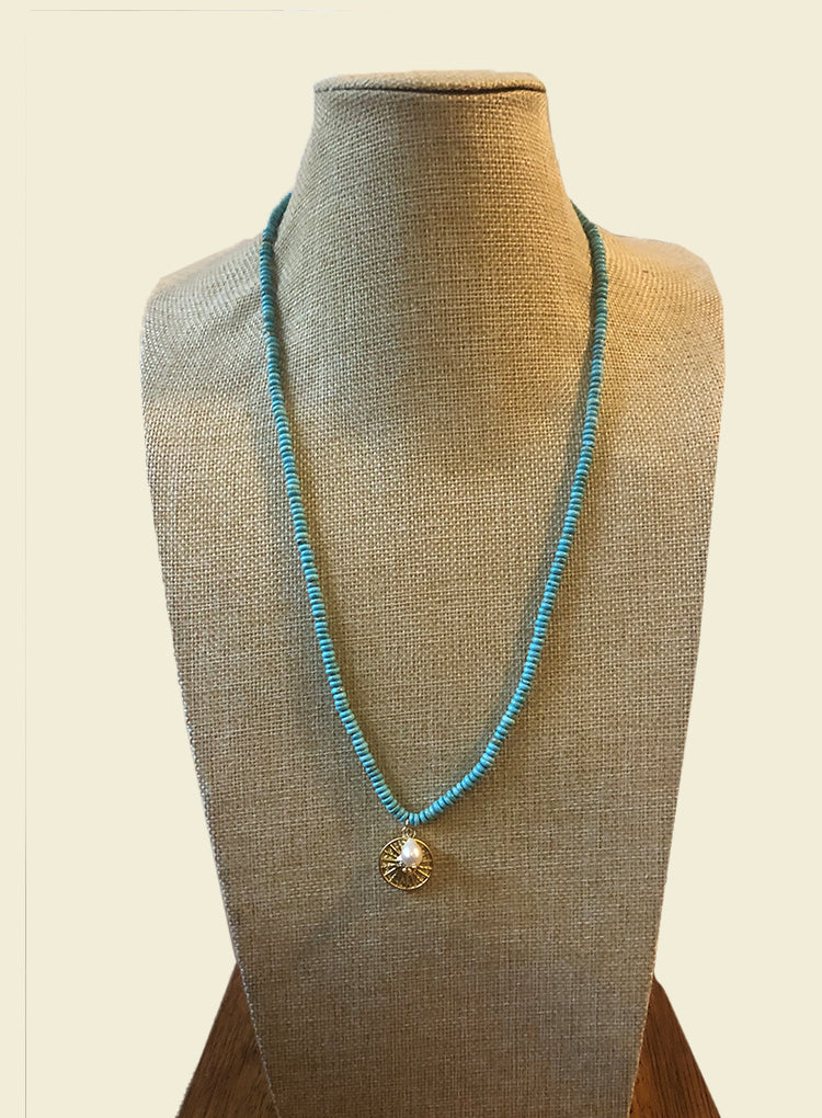 AMAVI LONG NATURAL TURQUOISE WITH MATTE GOLD MEDALION NECKLACE