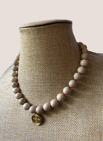 AMAVI 10MM RIVERSTONE RED KNOT CHOKER WITH MEDALLION