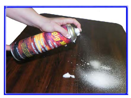 Applying Cleaning Foam to Wood Tabletop Surface