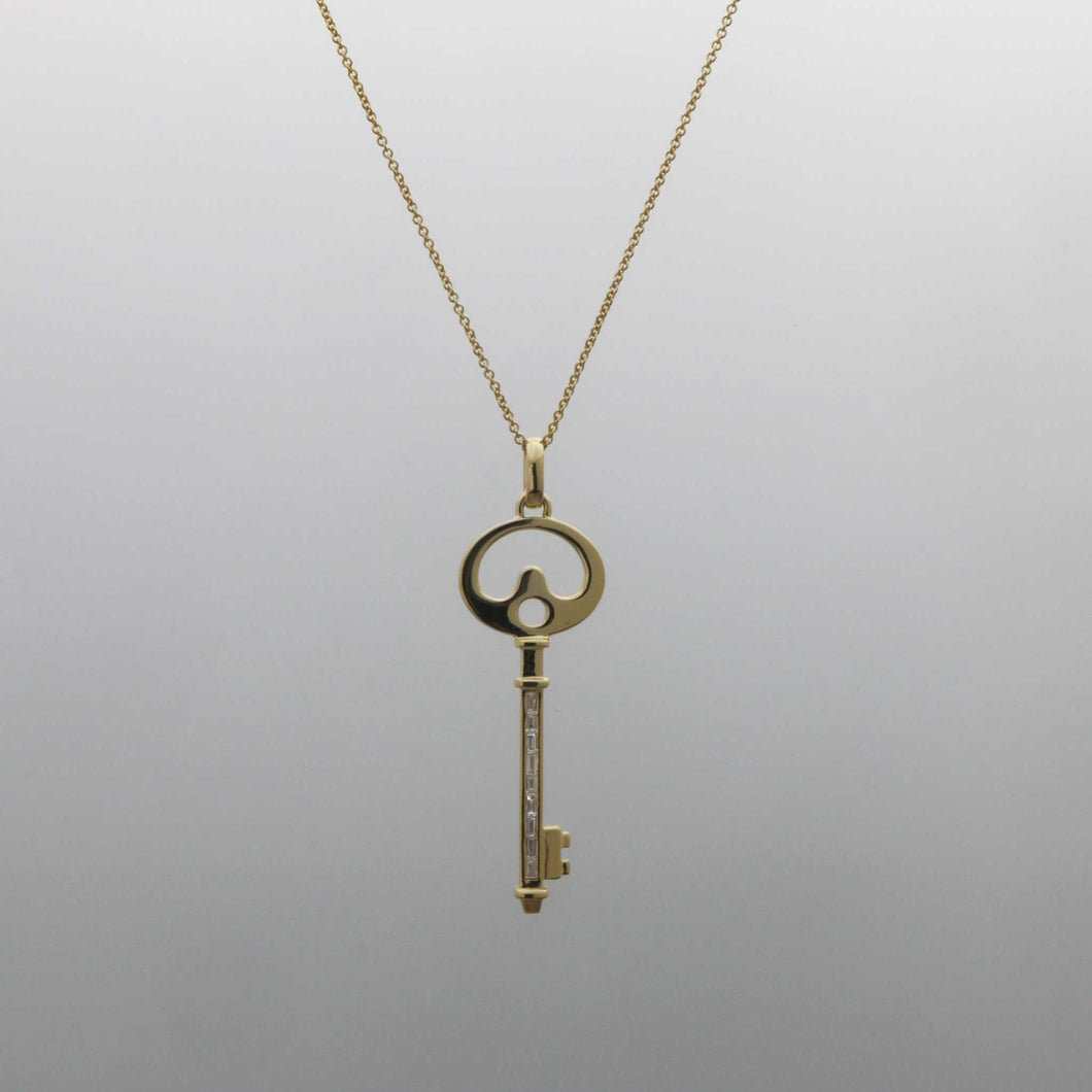 Deco Key Pendant with Channel Set Baguette Diamonds in Yellow Gold