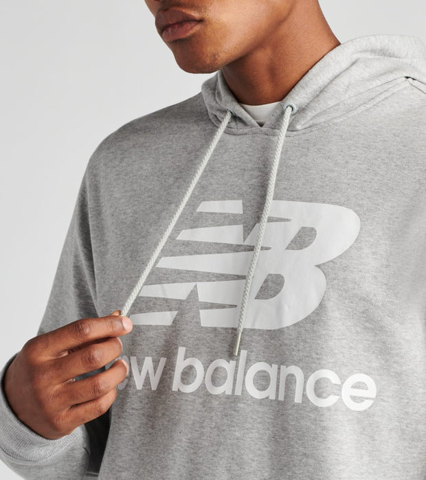 New Balance  Essentials Stacked Logo Pullover Hoodie  Grey - MT03558-AG | Jimmy Jazz