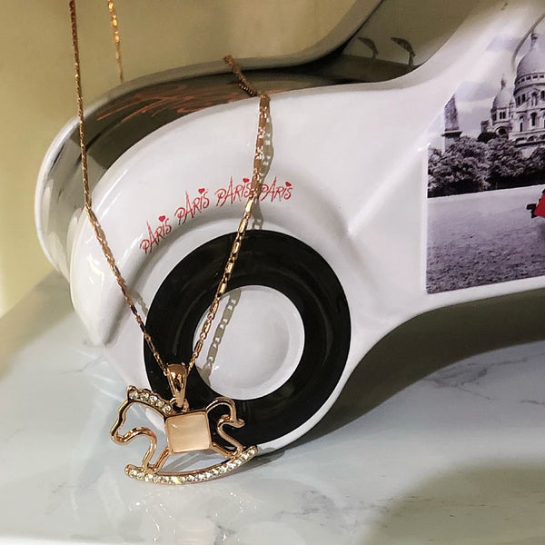 Rocking horse necklace