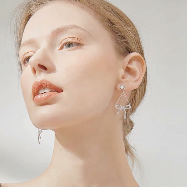 Audrey Garza's Dangling Ribbon Earrings