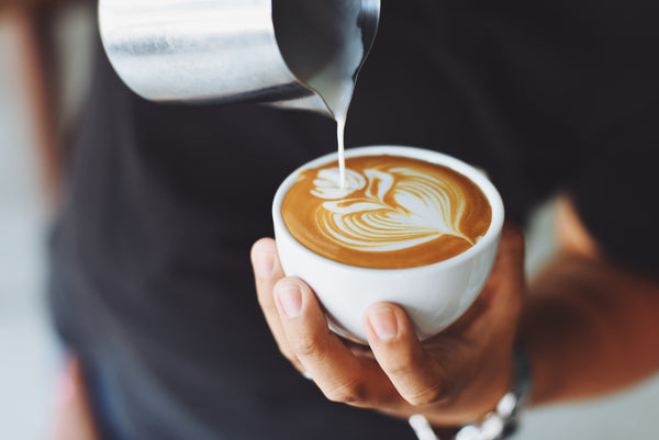Coffee intake could increase the risk of osteoporosis; pouring coffee into a cup
