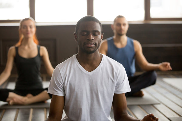man practices mindfulness with yoga