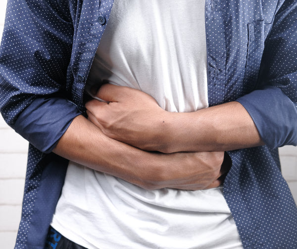 Man holding his stomach