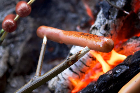 Cooking sausages on an open fire pit can be treacherous, but worth the risk!