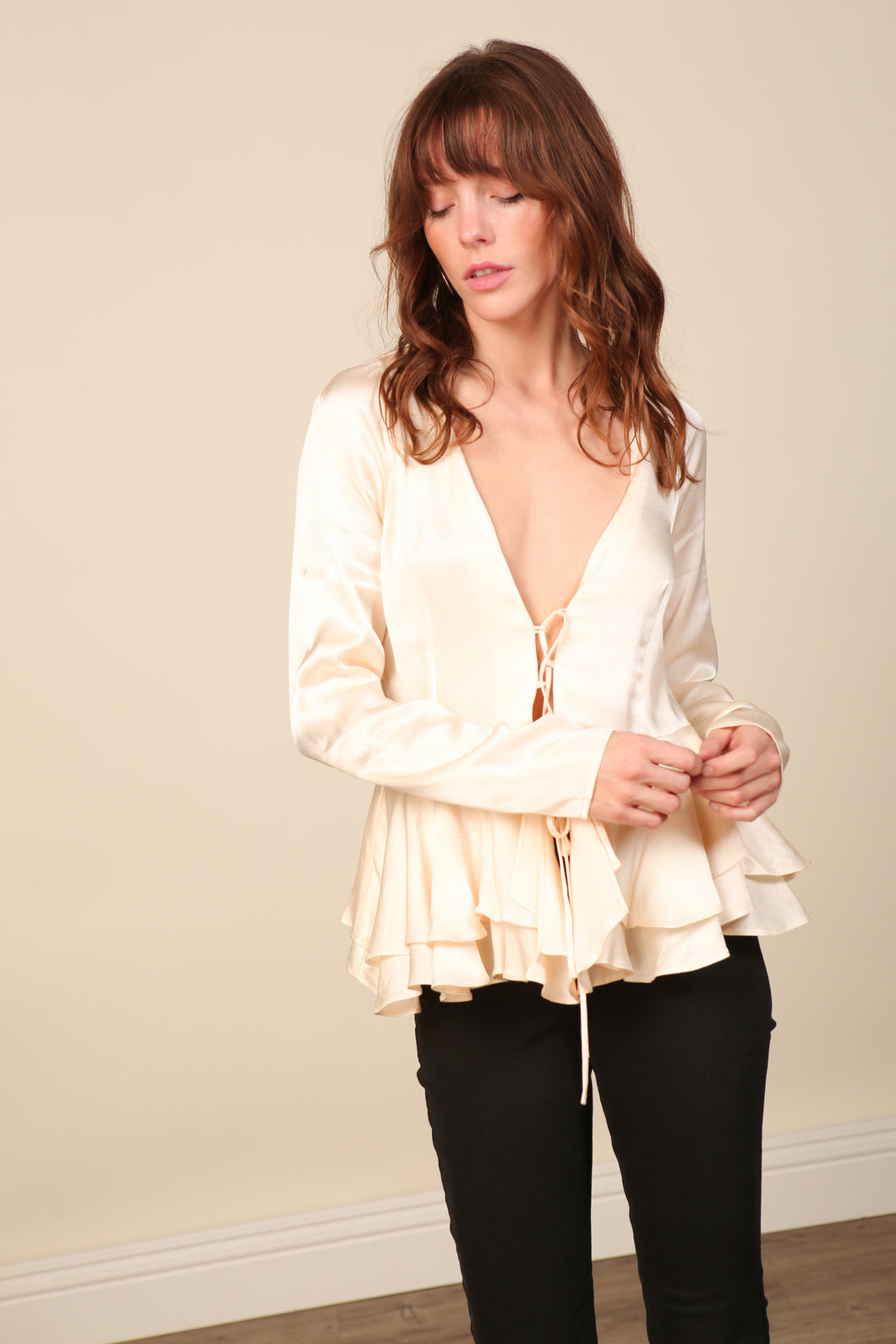 Elle Peplum Lace Up Top