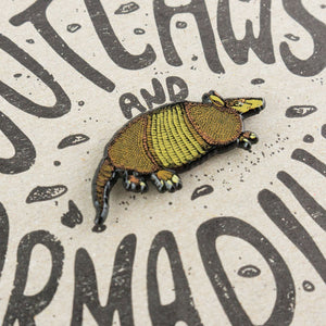 Outlaws & Armadillos Enamel Pin