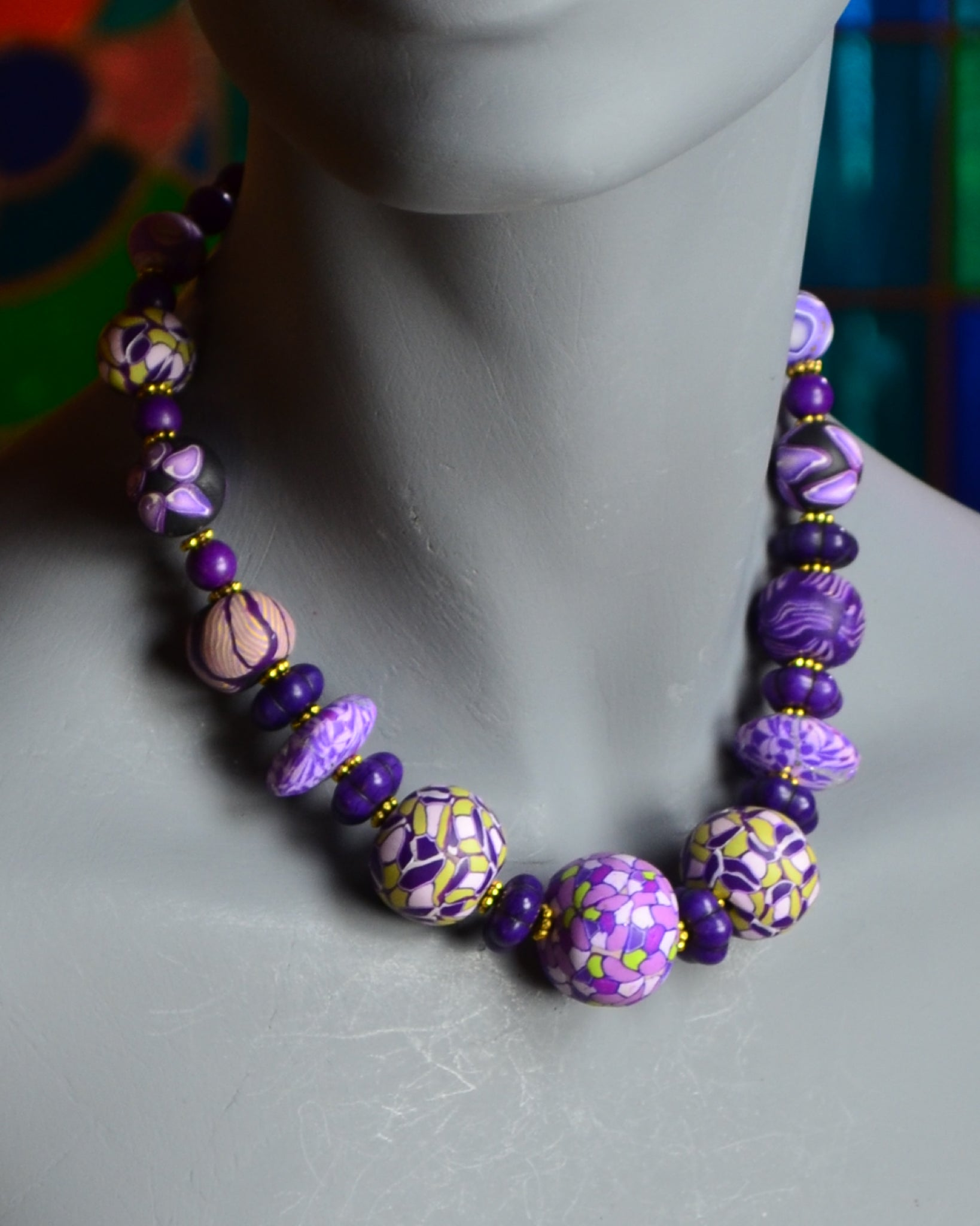handcrafted purple patterned rounds of polymer beads