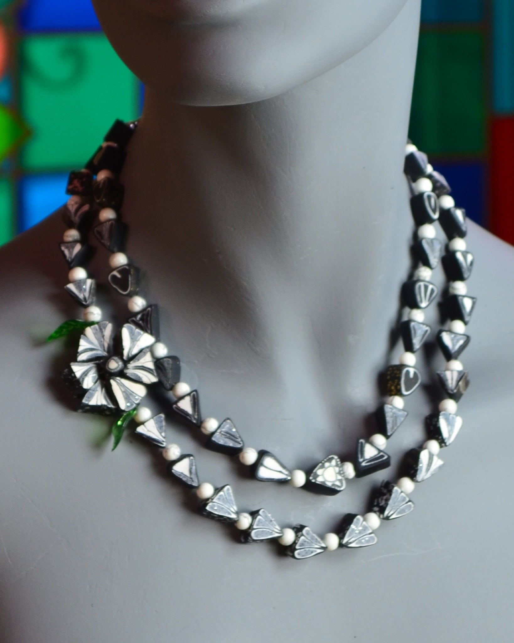 This necklace is made of delicate black and white polymer beads, yet its impact is powerful, reflecting a subtle competence and inner resilience of the modern woman.