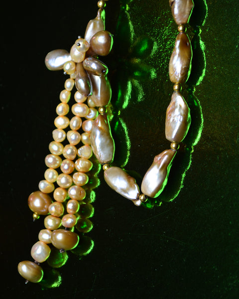 detail A simple strand of golden hewed beige pearls