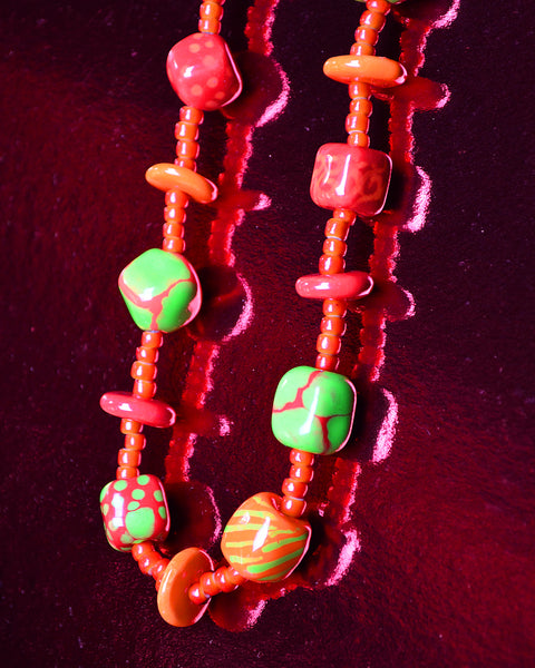 detail Red and green Kazuri beads, each handmade and hand painted
