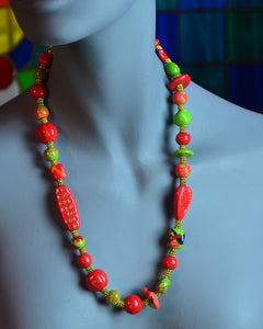 You are thinking about buying this exotic red and green necklace, but are wondering: what color can I wear it with? Imagine how beautiful it will look on a  soft white linen colored sweater or blouse and how smashing you will look in it!!