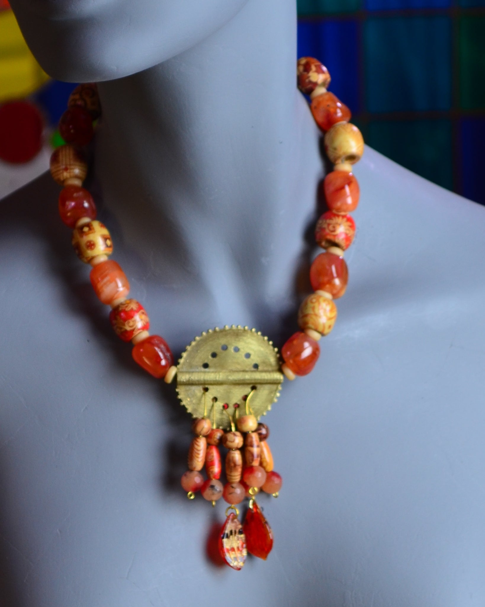 The printed wooden beads in this necklace are from China, where orange symbolizes transformation, as it is the perfect balance between yellow and red. So this necklace brings perfection to an imperfect world! Wear orange!