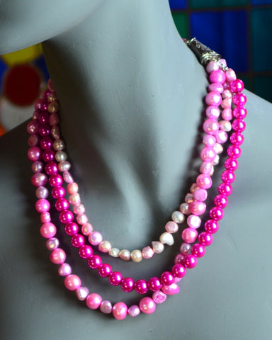 Three strands of pink fresh water pearls with pewter cones