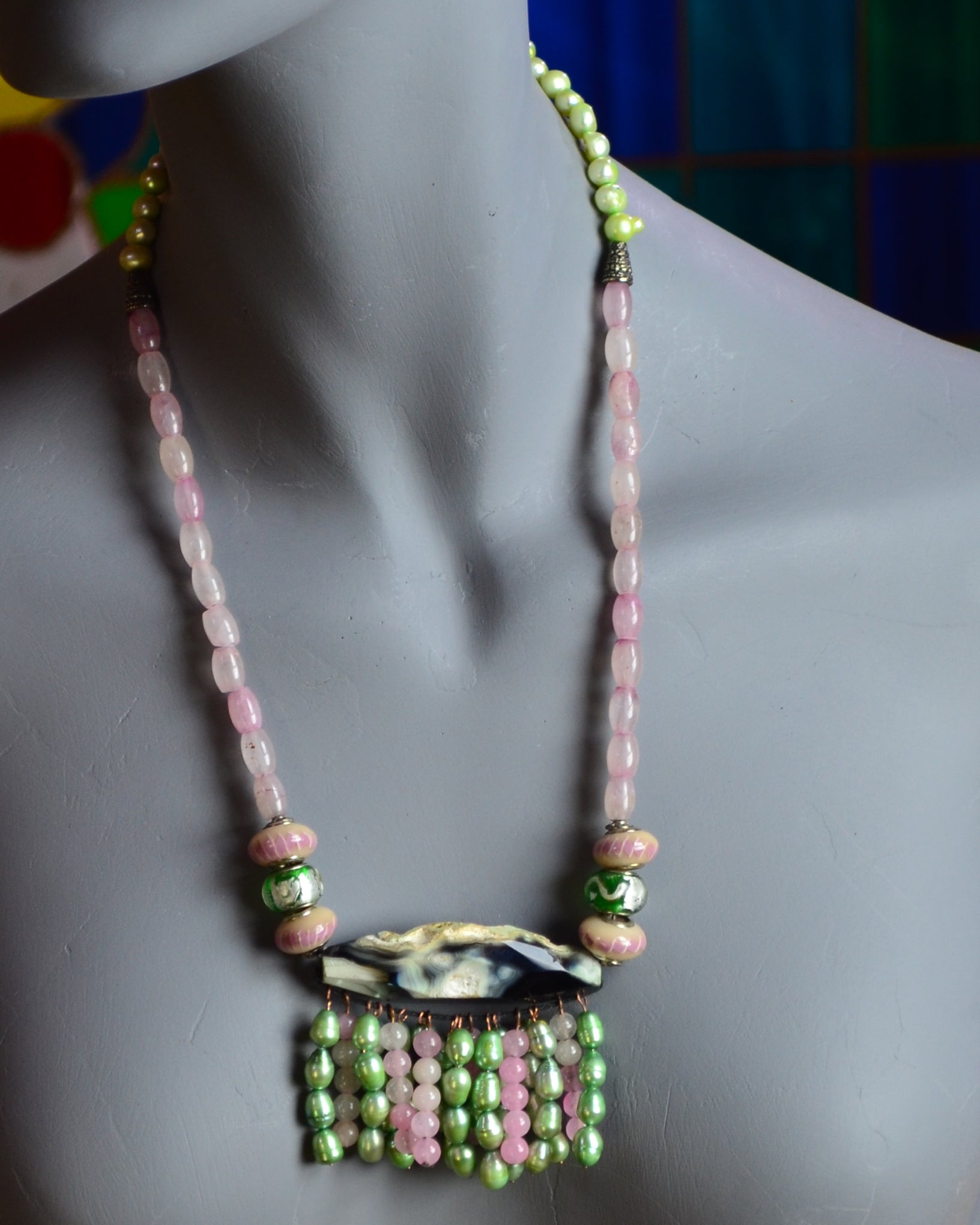 This necklace was inspired by the necklaces Afghani women wear, but instead of pearls, they garnish theirs with silver beads.