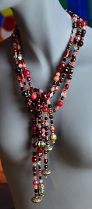 Want to be noticed, but not conspicuously? This is the perfect necklace, with its luxurious 6 strands of understated and calming cranberry colored beads.