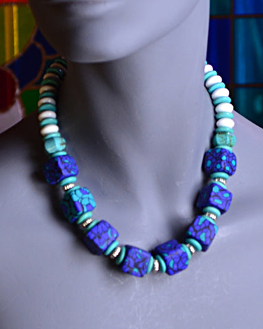 Handmade and crafted blue/green polymer beads