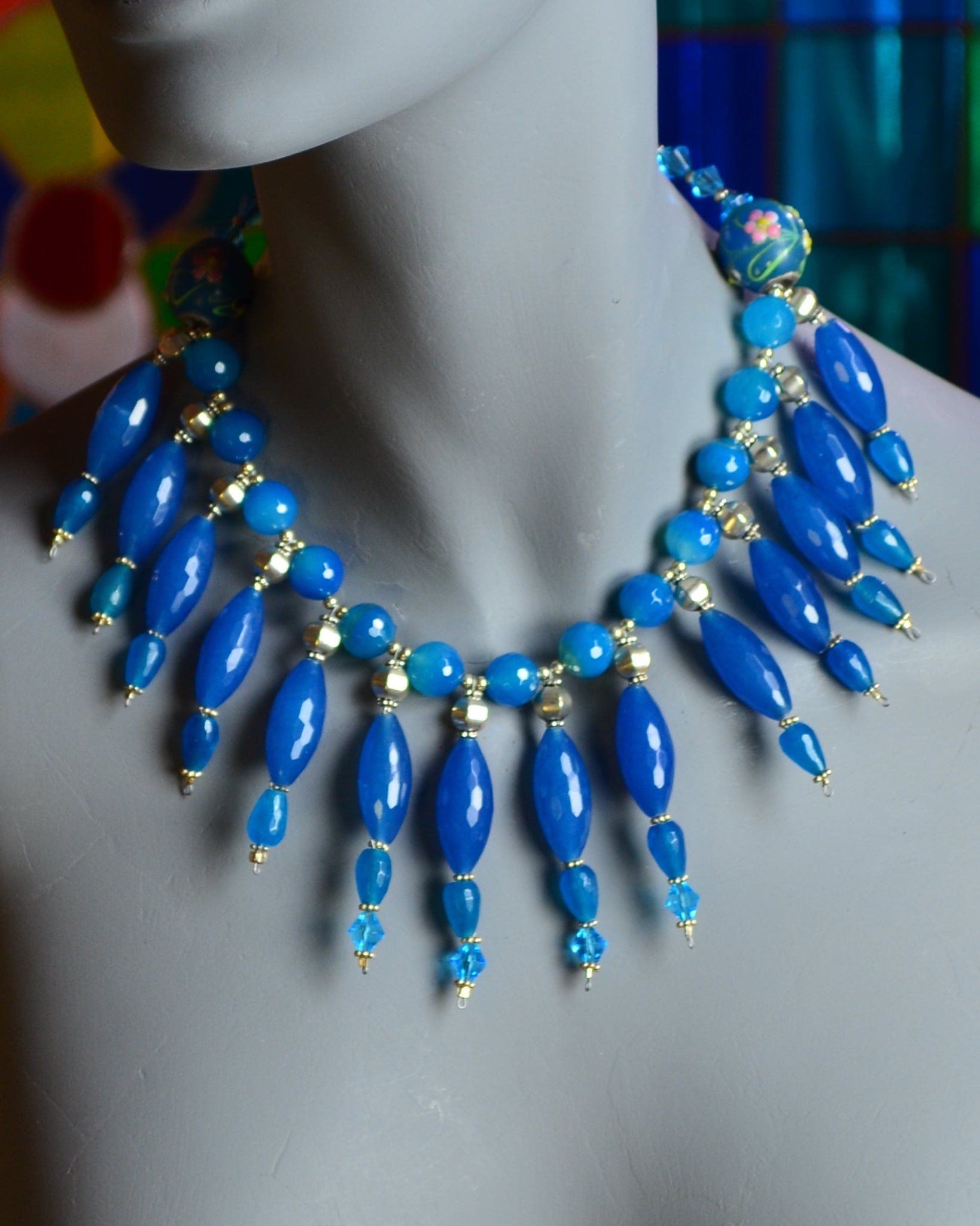 Blue faceted glass cylinder necklace